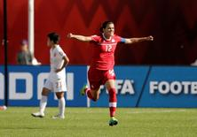 Canada forward Christine Sinclair (12) celebrates scoring a goal on a penalty kick against China goalkeeper Wang Fei (not pictured) during the second half in a Group A soccer match in the 2015 women's World Cup at Commonwealth Stadium. Mandatory Credit: Erich Schlegel-USA TODAY Sports