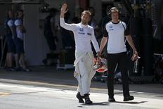 McLaren F1 driver Jenson Button of Britain  waves after the qualifying session of the Spanish Grand Prix at the Circuit de Barcelona-Catalunya racetrack in Montmelo, near Barcelona, Spain, in this file photo taken on May 9, 2015. REUTERS/Juan Medina