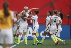 Jun 8, 2015; Winnipeg, Manitoba, CAN; United States midfielder Megan Rapinoe (15) celebrates scoring against Australia with forward Abby Wambach (20) and Megan Klingenberg defender (22) and midfielder Carli Lloyd (10)  in a Group D soccer match in the 2015 women's World Cup at Winnipeg Stadium. Mandatory Credit: USA TODAY Sports Images