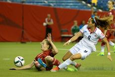 Jun 9, 2015; Montreal, Quebec, CAN; Spain defender Irene Paredes (20) dives as she tries to bock the kick of Costa Rica forward Carolina Venegas (9) in the second half of a Group E soccer match in the 2015 FIFA women's World Cup at Olympic Stadium. Mandatory Credit: Eric Bolte-USA TODAY Sports