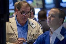 Traders work on the floor of the New York Stock Exchange June 5, 2015. REUTERS/Brendan McDermid