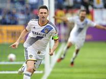 Dec 7, 2014; Los Angeles, CA, USA; Los Angeles Galaxy forward Robbie Keane (7) celebrates after scoring a goal against the New England Revolution in the overtime during the 2014 MLS Cup final at Stubhub Center. Mandatory Credit: Gary A. Vasquez-USA TODAY Sports