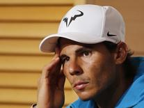 Rafael Nadal of Spain attends a news conference after being defeated by Novak Djokovic of Serbia during their men's quarter-final match at the French Open tennis tournament at the Roland Garros stadium in Paris, France, June 3, 2015.             REUTERS/Jean-Paul Pelissier