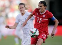 June 11, 2015; Edmonton, Alberta, CAN; Canada forward Christine Sinclair (12) moves the ball against New Zealand defender Rebekah Stott (6) during the first half in a Group A soccer match in the 2015 FIFA women's World Cup at Commonwealth Stadium. Mandatory Credit: Erich Schlegel-USA TODAY Sports