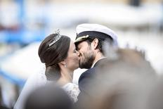 Swedish Prince Carl Philip and Sofia Hellqvist kiss after the carriage cortege during their wedding in the Royal Chapel in Stockholm, Sweden, June 13, 2015. REUTERS/Pontus Lundahl/TT News Agency