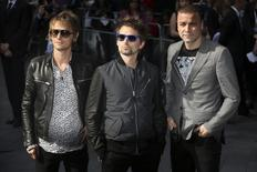 "Dominic Howard, Matthew Bellamy and Chris Wolstenholme (L-R) from the British rock band Muse arrive for the world premiere of the film ""World War Z"" in London June 2, 2013.  REUTERS/Neil Hall"