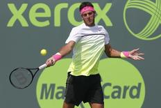 Mar 26, 2015; Key Biscayne, FL, USA; Juan Martin Del Potro hits a forehand against Vasek Pospisil (not pictured) on day three of the Miami Open at Crandon Park Tennis Center. Pospisil won 6-4, 7-6 (7). Mandatory Credit: Geoff Burke-USA TODAY Sports