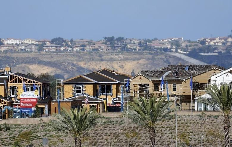 A residential housing project is shown under construction in Carlsbad, California March 23, 2015.  REUTERS/Mike Blake