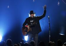 "Musician Neil Young performs ""Blowin' in the Wind"" during the 2015 MusiCares Person of the Year tribute honoring Bob Dylan in Los Angeles, California February 6, 2015. REUTERS/Mario Anzuoni"