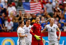 Jun 16, 2015; Vancouver, British Columbia, CAN; United States goalkeeper Hope Solo (1) and defender Becky Sauerbrunn (4) and defender Meghan Klingenberg (22) and defender Ali Krieger (11) celebrate their win over Nigeria in a Group D soccer match in the 2015 FIFA women's World Cup at BC Place Stadium.The United States won 1-0 and win Group B. Mandatory Credit: Michael Chow-USA TODAY Sports