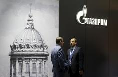 Men speak near the pavilion of Gazprom company at the St. Petersburg International Economic Forum 2015 in St. Petersburg, Russia, June 18, 2015. REUTERS/Maxim Shemetov
