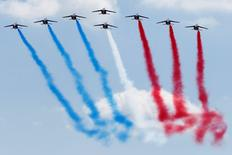 Alpha Jet aircraft from the Patrouille de France (PAF) participate in a flying display at the 51st Paris Air Show at Le Bourget airport near Paris, June 19, 2015. REUTERS/Pascal Rossignol