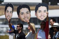 Jun 20, 2015; University Place, WA, USA; Fans of Jason Day (not pictured) hold up cutout heads along the 1st hole in the third round of the 2015 U.S. Open golf tournament at Chambers Bay. Michael Madrid-USA TODAY Sports