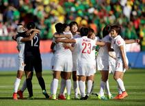 Jun 20, 2015; Edmonton, Alberta, CAN; China goalkeeper Wang Fei (12) celebrates with teammates after defeating Cameroon in the round of sixteen in the FIFA 2015 women's World Cup soccer tournament at Commonwealth Stadium. China won 1-0. Mandatory Credit: Erich Schlegel-USA TODAY Sports