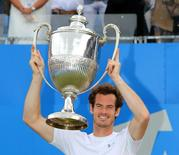 Aegon Championships - Queens Club, London - 21/6/15 Great Britain's Andy Murray celebrates winning the final with the trophy Action Images via Reuters / Paul Childs