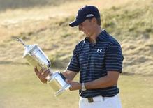 Jun 21, 2015; University Place, WA, USA; Jordan Spieth looks at the U.S. Open Championship Trophy after winning the 2015 U.S. Open golf tournament at Chambers Bay. Mandatory Credit: Michael Madrid-USA TODAY Sports