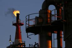 A flame shoots out of a chimney at a petro-industrial factory in Kawasaki near Tokyo December 18, 2014. Brent crude held steady above $61 a barrel on Thursday, bringing a sharp drop in prices to a temporary halt as companies are forced to cut upstream investments around the world. REUTERS/Thomas Peter (JAPAN - Tags: BUSINESS ENERGY)