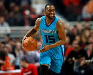 Mar 23, 2015; Chicago, IL, USA; Charlotte Hornets guard Kemba Walker (15) looks to pass the ball against the Chicago Bulls during the first half of their NBA game at United Center. Mandatory Credit: Kamil Krzaczynski-USA TODAY Sports