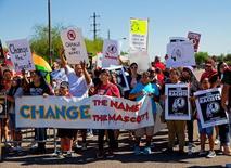 Oct 12, 2014; Glendale, AZ, USA; Native American indians protest the Washington Redskins name prior to the game against the Arizona Cardinals at University of Phoenix Stadium. Mandatory Credit: Mark J. Rebilas-USA TODAY Sports