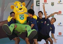 Dancers carry Brazilian olympic team mascot, Ginga, during the celebration of Olympic Day at the Maria Lenk aquatic center in Rio de Janeiro, Brazil, June 23, 2015.  REUTERS/Sergio Moraes