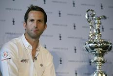 America's Cup skipper Ben Ainslie from Ben Ainslie Racing poses with the America's Cup during a news conference introducing the 35th America's Cup, in London September 9, 2014. REUTERS/Daniel Leal-Olivas