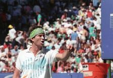 "John McEnroe of the U.S. argues with match umpire Gerry Armstrong during his fourth round match against Sweden's Mikael Perfors at the Australian Open January 21, 1990. Armstrong defaulted McEnroe in the fourth set of his match against Sweden's Mikael Pernfors, for being guilty of using ""particularly foul language.""   REUTERS/Mark Baker"