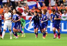 Jun 23, 2015; Vancouver, British Columbia, CAN; Japan defender Saori Ariyoshi (19) celebrates with teammates after scoring against the Netherlands during the first half in the round of sixteen in the FIFA 2015 women's World Cup soccer tournament at BC Place Stadium. Mandatory Credit: Anne-Marie Sorvin-USA TODAY Sports