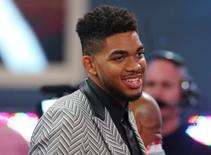 Jun 25, 2015; Brooklyn, NY, USA; Karl-Anthony Towns (Kentucky) smiles before the first round of the 2015 NBA Draft at Barclays Center. Mandatory Credit: Brad Penner-USA TODAY Sports