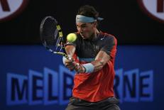 Rafael Nadal of Spain hits a return to Roger Federer of Switzerland during their men's singles semi-final match at the Australian Open 2014 tennis tournament in Melbourne January 24, 2014.     REUTERS/Jason Reed