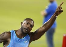 Justin Gatlin from the U.S. reacts after winning the men's 100 meters event during the Diamond League meeting in Doha, Qatar May 15, 2015.  REUTERS/AK Bijuraj/Files