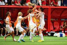 Jun 27, 2015; Vancouver, British Columbia, CAN; England midfielder Jill Scott (8) celebrates with teammates after defeating Canada in the quarterfinals of the FIFA 2015 Women's World Cup at BC Place Stadium. England won 2-1. Mandatory Credit: Anne-Marie Sorvin-USA TODAY Sports