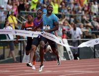 Jun 28, 2015; Eugene, OR, USA; Justin Gatlin celebrates after winning the 200m in a meet record 19.57 in the 2015 USA Championships at  Hayward Field. Mandatory Credit: Kirby Lee-USA TODAY Sports