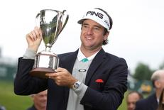 Jun 28, 2015; Cromwell, CT, USA; Bubba Watson hold up the Travelers Championship trophy after defeating Paul Casey in two sudden death holes in the final round of the Travelers Championship at TPC River Highlands. Mandatory Credit: David Butler II-USA TODAY Sports