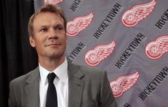 Detroit Red Wings defenseman Nicklas Lidstrom waits to talk with reporters following a news conference announcing his retirement from NHL hockey at Joe Louis Arena in Detroit, Michigan May 31, 2012.  REUTERS/Rebecca Cook