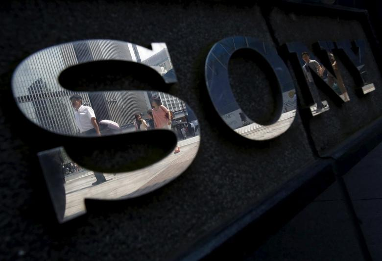 Pedestrians are reflected in a logo of Sony Corp outside its showroom in Tokyo, Japan, June 23, 2015. REUTERS/Yuya Shino