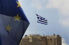 La Grèce n'a pas encore officiellement réagi à l'offre de la dernière chance soumise par les créanciers pour débloquer une aide financière mais des contacts sont en cours. /Photo prise le 26 juin 2015/REUTERS/Yannis Behrakis
