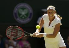 Petra Kvitova of Czech Republic hits a shot during her match against Kiki Bertens of the Netherlands at the Wimbledon Tennis Championships in London, June 30, 2015.   REUTERS/Henry Browne