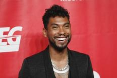 Singer Miguel poses at the 2014 MusiCares Person of the Year gala honoring Carole King in Los Angeles, January 24, 2014.  REUTERS/Danny Moloshok
