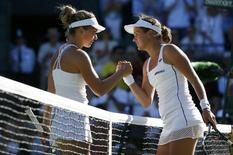 Jana Cepelova of Slovakia shakes hands with Simona Halep of Romania after winning their match at the Wimbledon Tennis Championships in London, June 30, 2015.     REUTERS/Stefan Wermuth