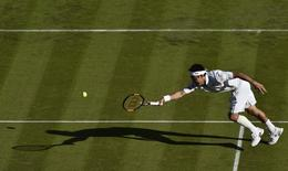 Kei Nishikori of Japan stretches for a shot during his match against Simone Bolelli of Italy at the Wimbledon Tennis Championships in London, June 29, 2015.  REUTERS/Toby Melville