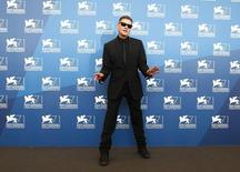 """Director Andrew Niccol poses during the photo call for the movie """"Good kill"""" at the 71st Venice Film Festival September 5, 2014. REUTERS/Tony Gentile"""