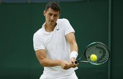 Bernard Tomic of Australia hits a shot during his match against Pierre-Hugues Herbert of France at the Wimbledon Tennis Championships in London, July 1, 2015.      REUTERS/Stefan Wermuth