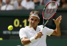 Roger Federer of Switzerland hits a shot during his match against Sam Querrey of the U.S.A. at the Wimbledon Tennis Championships in London, July 2, 2015.          REUTERS/Stefan Wermuth
