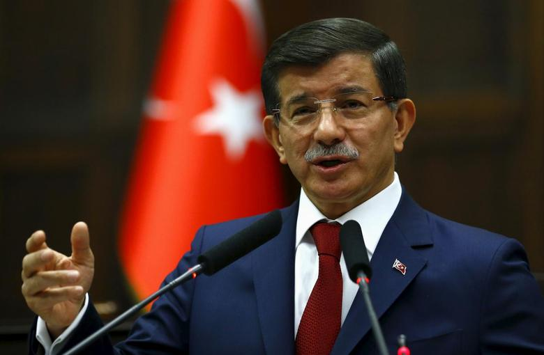 Turkey's Prime Minister Ahmet Davutoglu addresses members of parliament from his ruling AK Party (AKP) during a meeting at the Turkish parliament in Ankara, Turkey, June 30, 2015. REUTERS/Umit Bektas