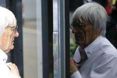 Formula One impresario Bernie Ecclestone is reflected in the window of his bus before the start of the Austrian F1 Grand Prix at the Red Bull Ring circuit in Spielberg, Austria, June 21, 2015.  REUTERS/Leonhard Foeger
