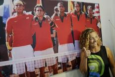 Former women's Tour player Gala Leon poses for the media after attending a news conference in the Andalusian capital of Seville September 23, 2014. REUTERS/Marcelo del Pozo
