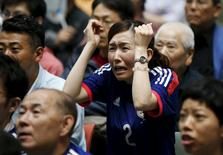 A Japan soccer fan reacts as she watches Japan's FIFA Women's World Cup final match against the U.S. in Vancouver, at a public viewing event in Tokyo, Japan, July 6, 2015. Japan lost the match 5-2 to the U.S.  REUTERS/Toru Hanai
