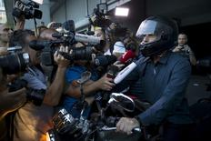 Greek Finance Minister Yanis Varoufakis talks to the media as he leaves the Finance Ministry building on his motorbike in Athens, Greece, July 1, 2015. A defiant Prime Minister Alexis Tsipras urged Greeks on Wednesday to reject an international bailout deal, wrecking any prospect of repairing broken relations with EU partners before a referendum on Sunday that may decide Greece's future in Europe.  REUTERS/Marko Djurica      TPX IMAGES OF THE DAY      - RTX1IN6I