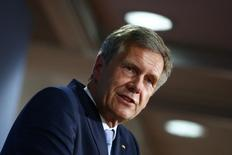"Former German President Christian Wulff presents his book ""Ganz Oben. Ganz Unten"" (At the Top. At the Bottom), in which he chronicles the events surrounding his resignation, during a news conference in Berlin, June 10, 2014. REUTERS/Thomas Peter"