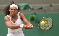 Jul 6, 2015; London, United Kingdom; Serena Williams (USA) in action during her match against  Venus Williams (USA) on day seven of The Championships Wimbledon at the AELTC. Susan Mullane-USA TODAY Sports
